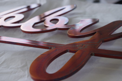 Bootis Natural - Aged Copper OIled to to aluminum laser cut lettering