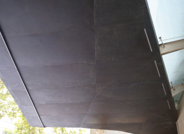 Bootis Natural - Aged Copper Oiled to to stainless panels on sculptural bus awning