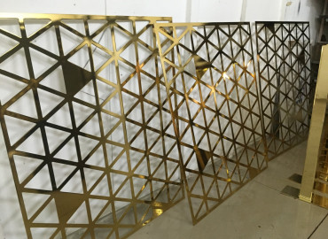 Pavonis Gold plated metal lasercut screens for commercial office fitout
