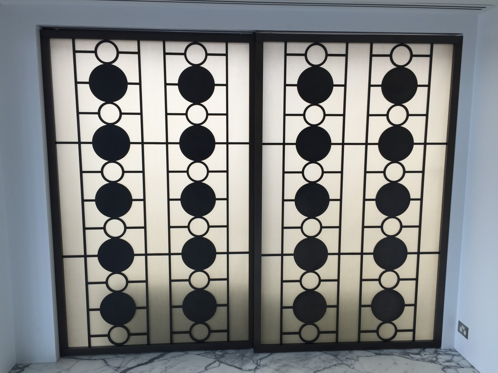 MIld steel lasercut screens for feature backlit screen, Fabricated by Ogis with Dark Brown Bronze Matt (Blackened brass)