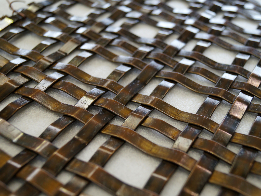 Aged brass ribbon mesh panels for exterior & courtyard screening, residential project by Luigi Roselli