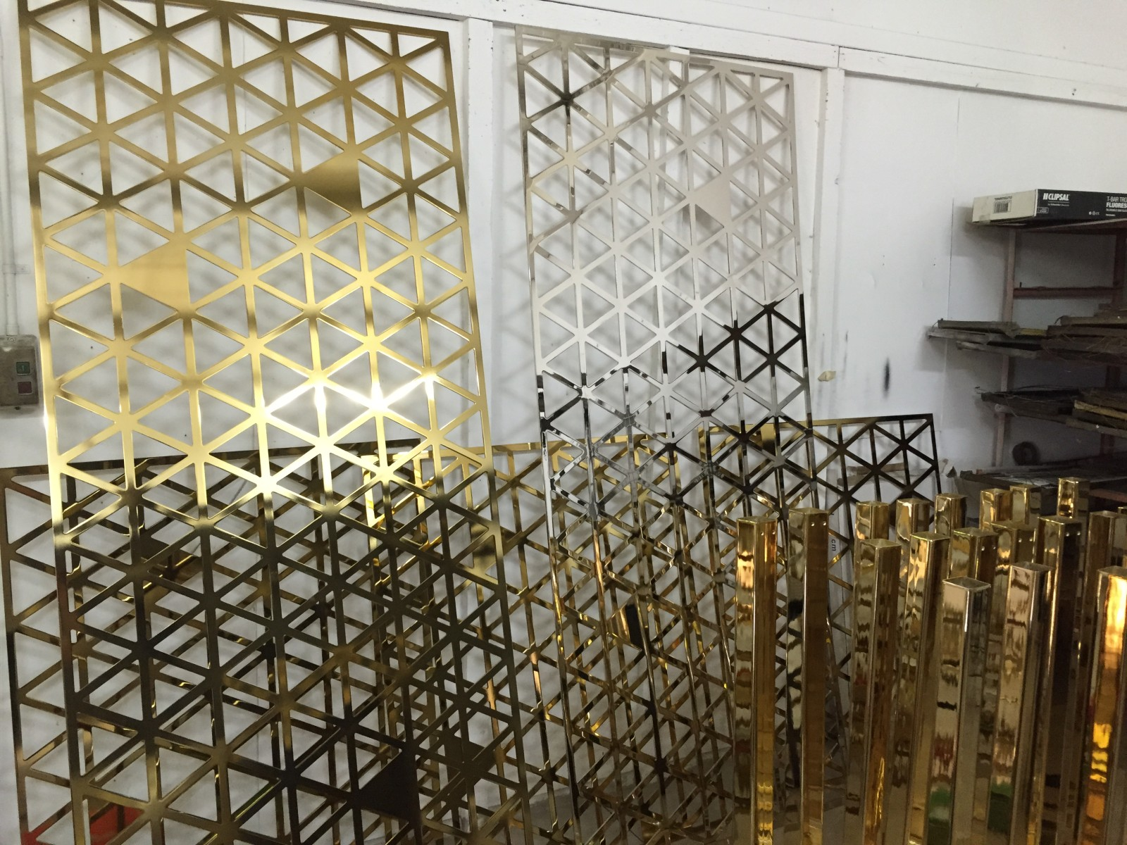 Laser cut 3mm aluminium screens; mirror polished and brass-plated