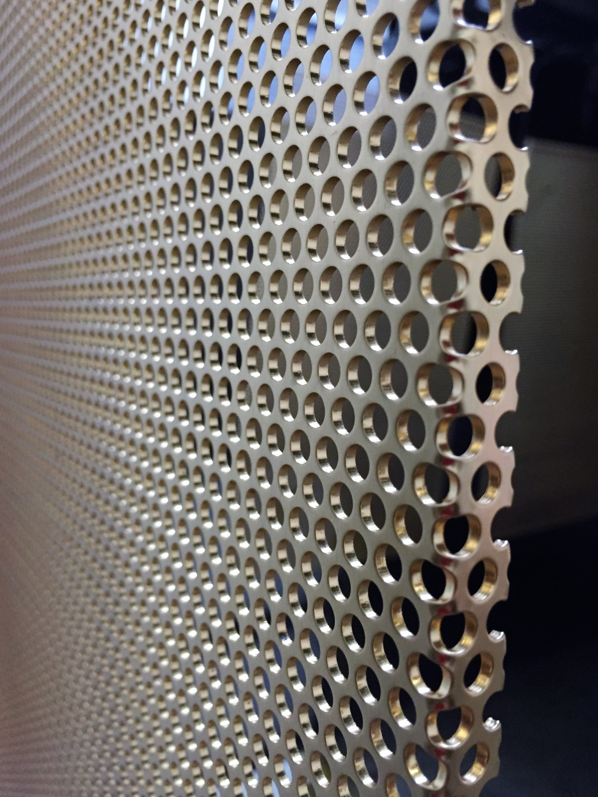 Locker Group perforated panels, folded and gold plated for sliding door screens